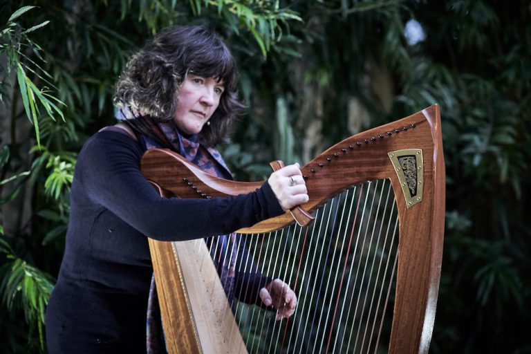 Stacey Blythe with harp at Willow Globe