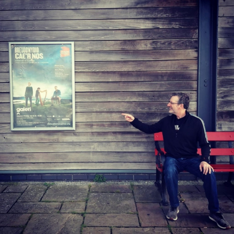 Michael Harvey spots himself on a poster at Galeri Caernarfon