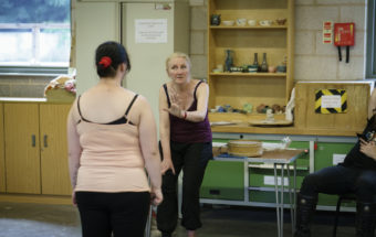 Maria Whatton in a Stars and Stories rehearsal with a young person