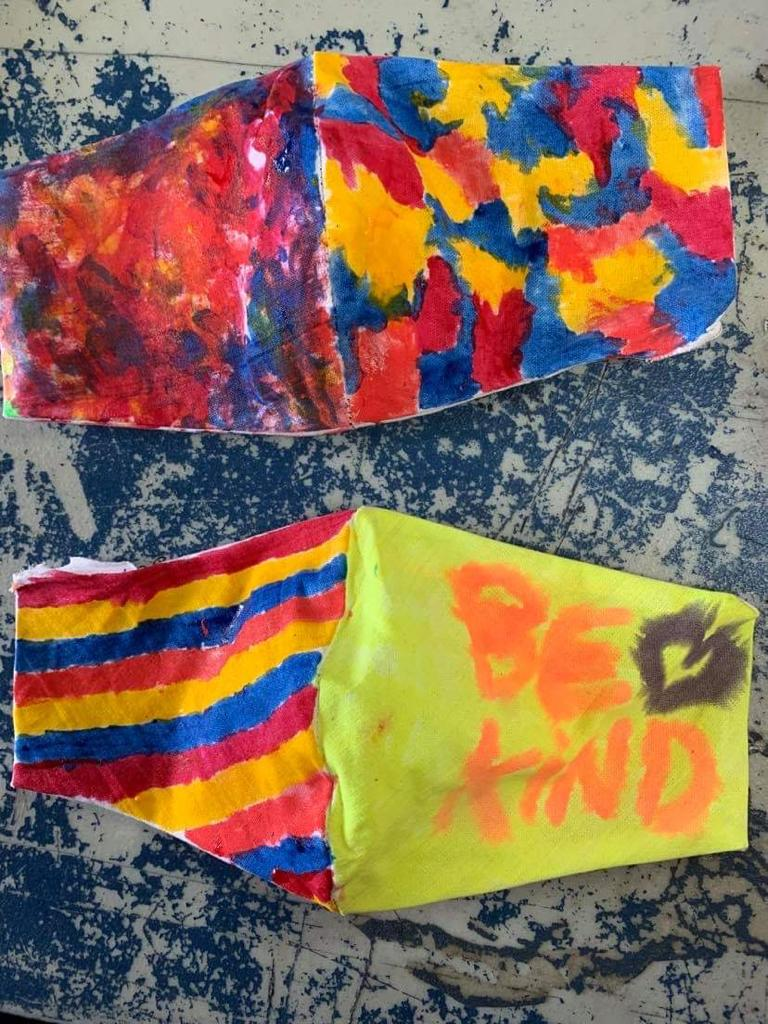hand painted face masks with 'be kind'