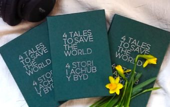 4 tales box set with daffodils and headphones